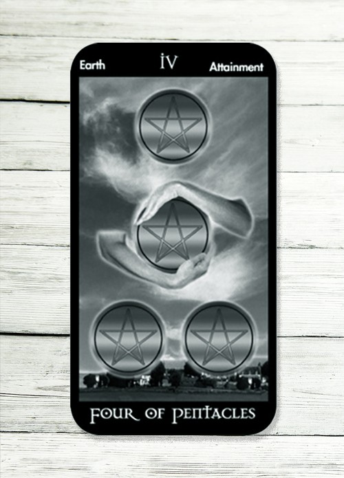 four of pentacles tarot meaning